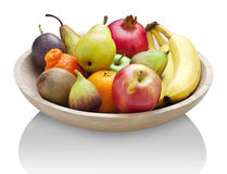 Fruit Wood Bowl Food. Fresh fruit in a wood bowl on a white background with a reflection royalty free stock photography