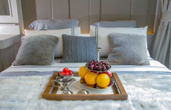 Fruit in a wood tray on bed Royalty Free Stock Images