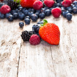 Fruit on wooden background. Royalty Free Stock Images