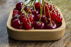 Fruit in a wooden bowl Stock Photo