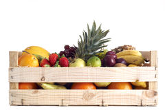 Fruit in wooden box. Various types of fruit stored in wooden box on white background royalty free stock photography