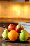 Fruit on a wooden plate Royalty Free Stock Images