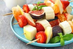 Fruit on wooden skewers - dessert. Skewers Stock Photo
