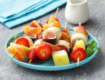 Fruit on wooden skewers - dessert Royalty Free Stock Image