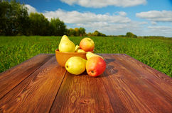 Fruit on a wooden table Royalty Free Stock Images