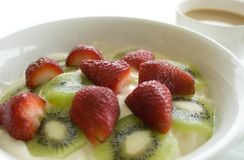 Fruit yoghurt breakfast. Fruit yoghurt and a cup of tea with a high key background Stock Photos