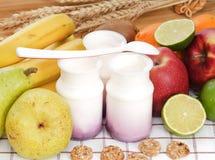 Fruit yogurt with cereal Stock Photos