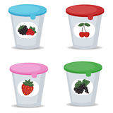 Fruit yogurt in plastic boxes Royalty Free Stock Images