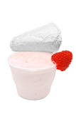 Fruit yogurt in plastic container on white Royalty Free Stock Image