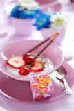 Fruit yogurt with small gift Royalty Free Stock Photos