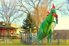 Fruita Town Circle At Christmas. Greta the Dinosaur, the Grinch, and holiday decorations in the town circle of Fruita Colorado Royalty Free Stock Images