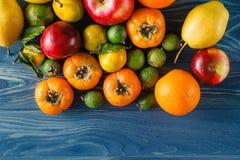 Fruitage on blue table Stock Photos