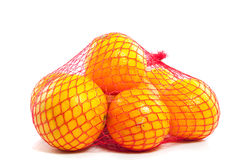 A fruitbag of healthy oranges. A fruitbag full of healthy oranges  isolated over white Stock Photos