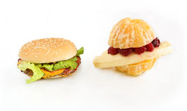 Fruitburger contro il cheeseburger Immagini Stock Libere da Diritti