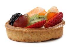 Fruitcake. Close-up image of a tadty fruitcake against a white background Stock Image