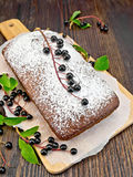 Fruitcake bird cherry with berries on board Stock Image