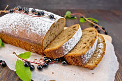 Fruitcake bird cherry cut with berries on board Stock Images