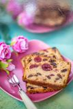Fruitcake or cupcake on a pink plate. royalty free stock photography
