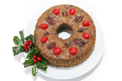 Fruitcake de la Navidad en blanco Foto de archivo libre de regalías