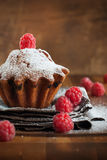 Fruitcake Decorated with Raspberry at the wooden table Royalty Free Stock Photography