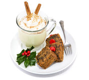 Fruitcake and Eggnog Isolated. Plate of Christmas fruitcake and delicious frothy eggnog isolated on white Royalty Free Stock Images