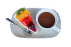 Fruitcake en koffiekop Stock Fotografie