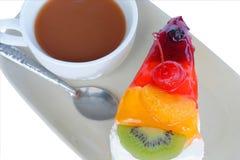 Fruitcake en koffiekop Stock Foto's