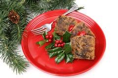 Fruitcake na placa vermelha foto de stock