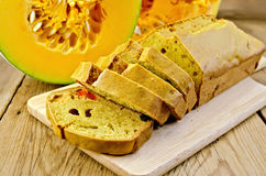 Fruitcake pumpkin with candied fruits on a board Stock Image
