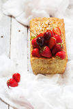 Fruitcake with strawberry and cherry topping Stock Photography