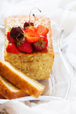 Fruitcake with strawberry and cherry topping Stock Images