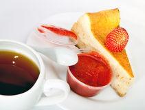 Fruitcake with a strawberry and a cup of tea Royalty Free Stock Photos