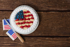 Fruitcake with 4th july theme. On wooden table Stock Photography