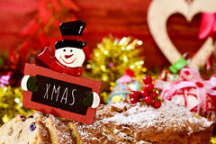 Fruitcake topped with a chalkboard with the text xmas Royalty Free Stock Images