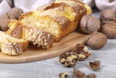 Fruitcake and walnuts. Tasty fruitcake, walnuts, fresh baking Royalty Free Stock Photo