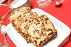 Fruitcake on a white plate Stock Image
