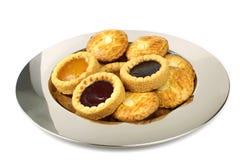 Fruitcakes on a metal plate Royalty Free Stock Photos
