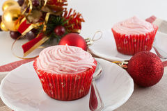 Fruitcakes in paper baskets on a New Year's table Stock Photos