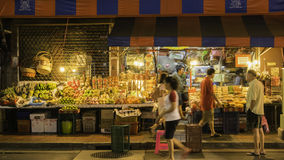 Fruiterer selling many types of fruit on china town (Yaowarat) Road,the main street in Chinatown. Stock Image