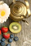 Fruites mix with old teapot Royalty Free Stock Photo