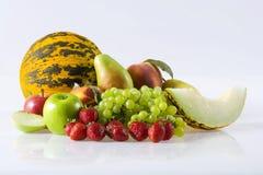 Fruits. Fresh fruits on the white background Stock Photos