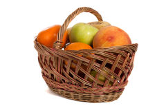 Fruits. A lot of fruits in basket isolated on white background Royalty Free Stock Photos