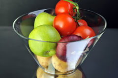 Fruits. Tomato apple onion and potato in vase Stock Images