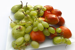 Fruits. On theplate on the white background Stock Photo