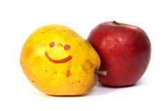 Fruits. Pear, and apple with the drawn smile Stock Photo