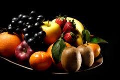 Fruits. Composition with orange, grape fruit, apple, strawberry, kiwi on black background Stock Photography