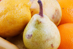 Fruits. Horizontal background of oranges, pears and lemons Stock Photo
