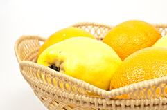 Fruits. Isolated basket with pears and oranges fruits Royalty Free Stock Images