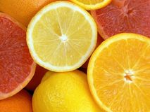 Fruits. Juicy fruits. Lemons, oranges and grapefruits Royalty Free Stock Image
