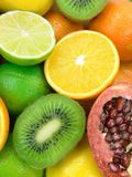 Fruits. Pomegranate, oranges, limes, lemons and kiwi fruits Stock Photo